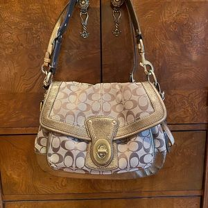 Coach shoulder bag and matching wallet.